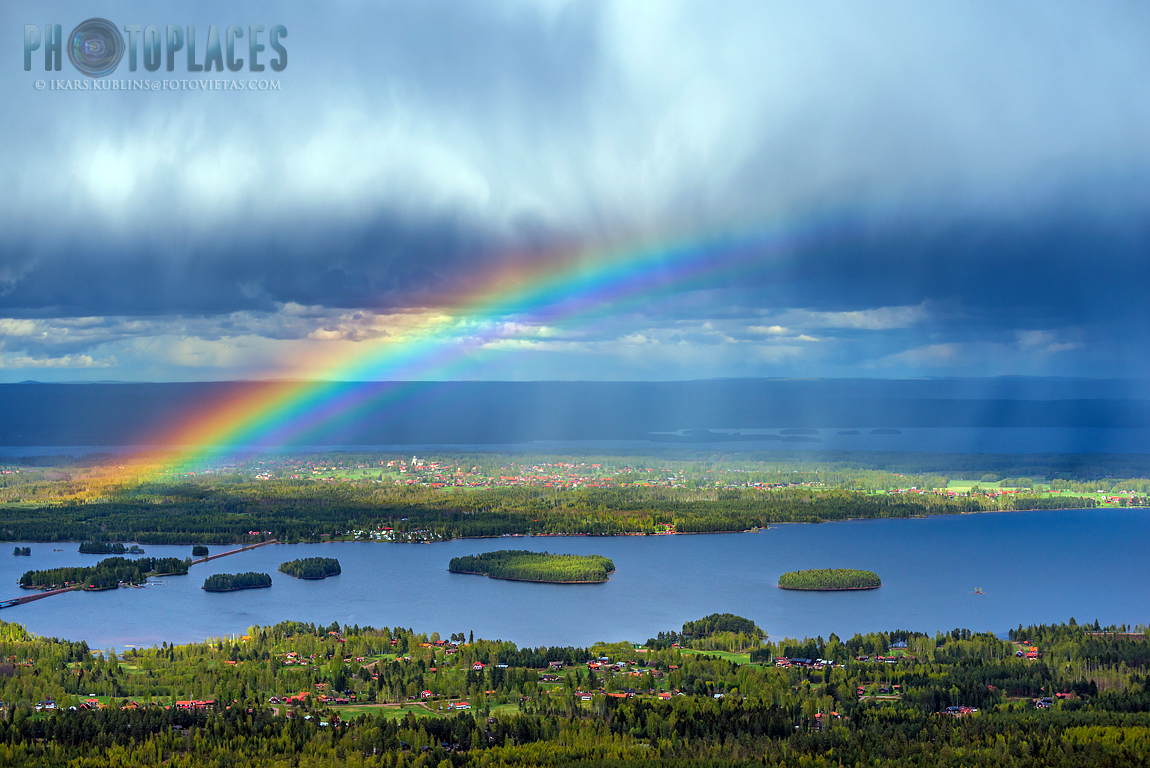 Siljan lake and Solleron island with rainbow and rain cloud